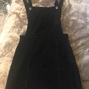 Black overall miniskirt